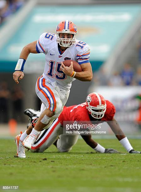Quarterback Tim Tebow of the Florida Gators runs with the ball against the Georgia Bulldogs at Jacksonville Municipal Stadium on November 1 2008 in...