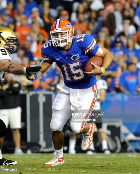 Quarterback Tim Tebow of the Florida Gators rushes upfield against the Vanderbilt Commodores November 7, 2009 at Ben Hill Griffin Stadium in...