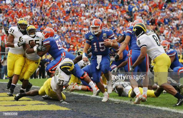 Quarterback Tim Tebow of the Florida Gators scores a touchdown in the third quarter while taking on the Michigan Wolverines in the Capital One Bowl...