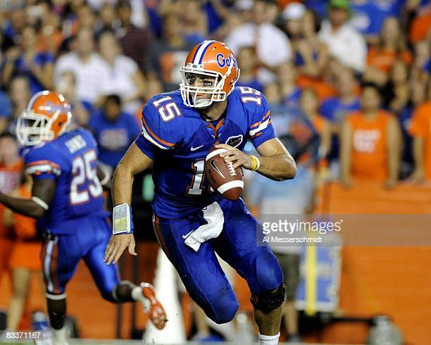 Quarterback Tim Tebow of the Florida Gators sets to run against the LSU Tigers at Ben Hill Griffin Stadium on October 11, 2008 in Gainesville,...