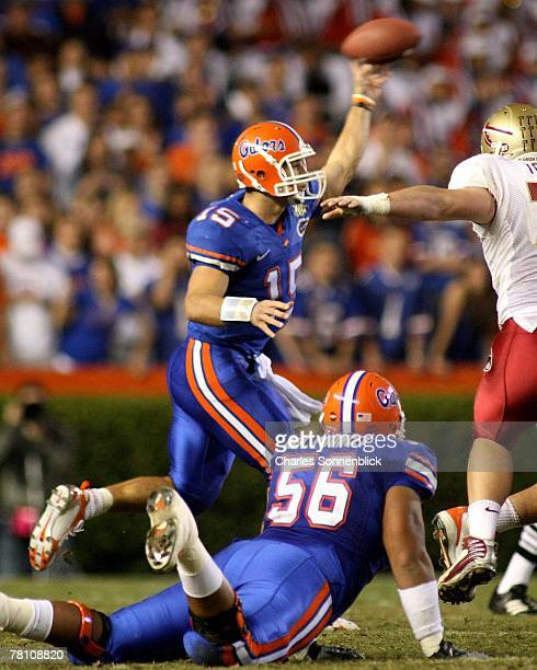 Quarterback Tim Tebow of the Florida Gators throws a touchdown pass to wide receiver Louis Murphy during the game against the Florida State Seminoles...