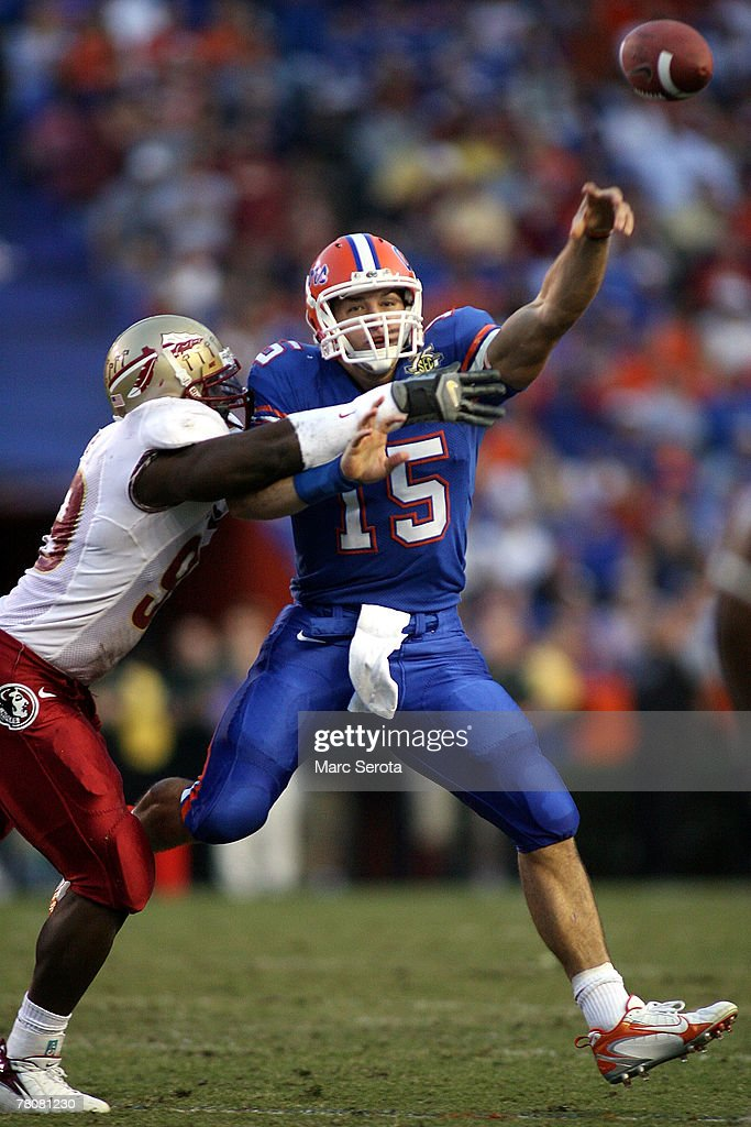 Quarterback Tim Tebow #15 of the Florida Gators throws while being pressured by defensive end Everette Brown #99 of the Florida State Seminoles at Ben Hill Griffin Stadium November 24, 2007 in Gainesville, Florida.