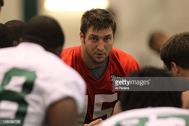 Quarterback Tim Tebow of the New York Jets participates in Organized Team Activities on May 24 2012 in Florham Park New Jersey