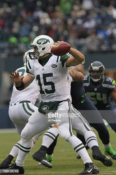 Quarterback Tim Tebow of the New York Jets passes the ball against the Seattle Seahawks at Qwest Field on November 11 2012 in Seattle Washington