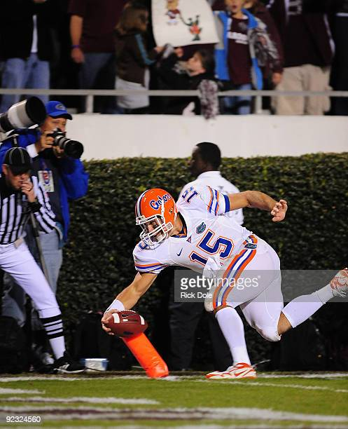Quarterback Tim Tebow of the University of Florida Gators scores a touchdown in the 2nd quarter against the Mississippi State Bulldogs at Davis Wade...
