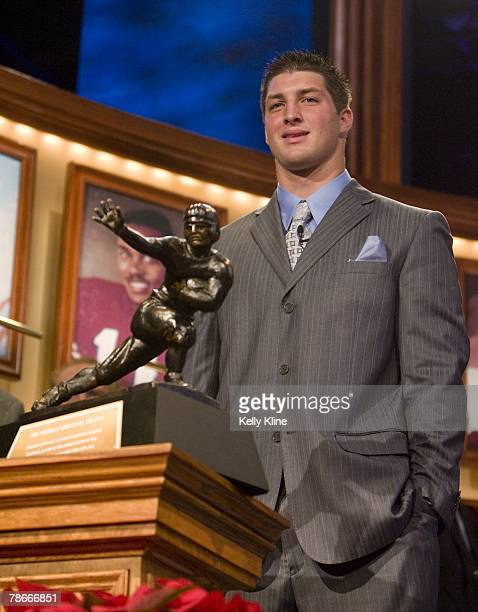 Quarterback Tim Tebow of the University of Florida poses with the Heisman Trophy Tebow was named the 73rd Heisman Trophy Winner on December 8 2007 in...