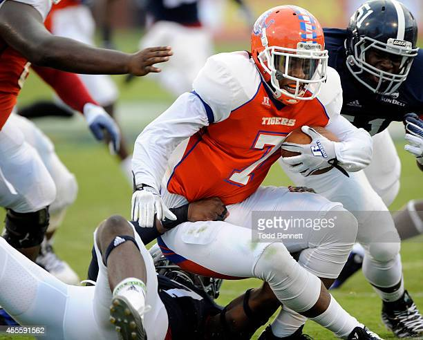 Quarterback Tino Smith II of the Savannah State Tigers is sacked by linebacker Antwione Williams of the Georgia Southern Eagles during the second...