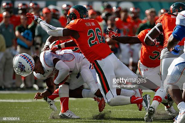 Quarterback Tino Smith of the Savannah State Tigers looses his helmet as he is tackled by Kevin PierreLouis of the Colorado State Rams at Sonny...