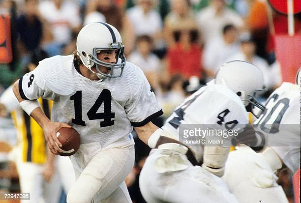 Quarterback Todd Blackledge of the Penn State Nittany Lions drops back during a game against the University of Miami Hurricanes on October 31, 1981...