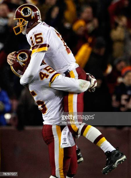 Quarterback Todd Collins of the Washington Redskins jumps into the arms of running back Mike Sellers after throwing a touchdown in the fourth quarter...