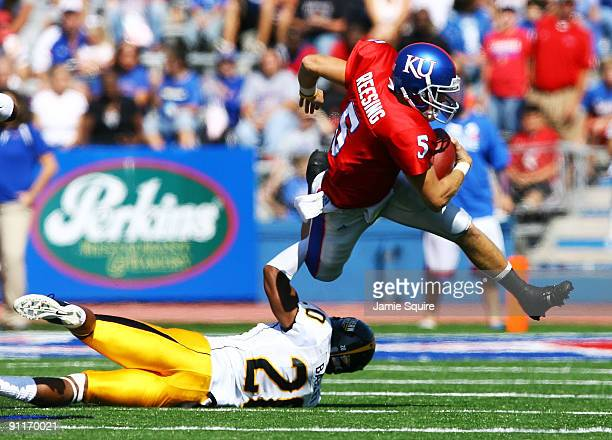 Quarterback Todd Reesing of the Kansas Jayhawks evades CJ Bailey of the Southern Mississippi Golden Eagles during the game on September 26 2009 at...