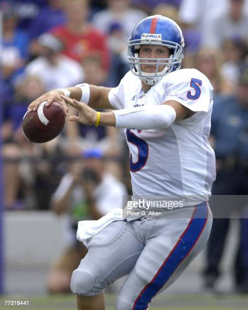 Quarterback Todd Reesing of the Kansas Jayhawks gets ready to throw the ball down field against the Kansas State Wildcats, during a NCAA football...
