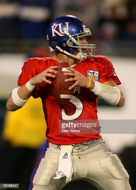 Quarterback Todd Reesing of the Kansas Jayhawks looks to pass during the FedEx Orange Bowl against the Virginia Tech Hokie at Dolphin Stadium on...