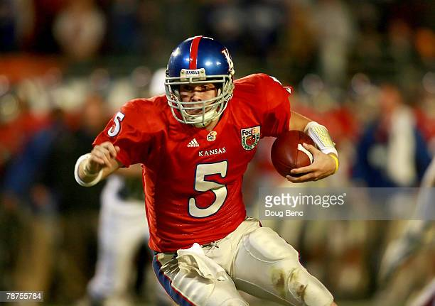 Quarterback Todd Reesing of the Kansas Jayhawks rushes in two yards for a touchdown in the fourth quarter of the FedEx Orange Bowl against the...