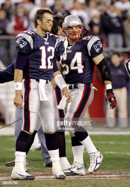 Quarterback Tom Brady and linebacker Tedy Bruschi of the New England Patriots stand on the field before their game against the Buffalo Bills on...