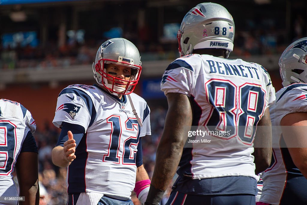 Quarterback Tom Brady #12 celebrates with tight end Martellus Bennett #88 of the New England Patriots after Bennett scored a touchdown during the first half against the Cleveland Browns at FirstEnergy Stadium on October 9, 2016 in Cleveland, Ohio.