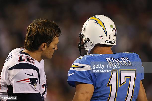 Quarterback Tom Brady of the New England Patriots and quarterback Philip Rivers of the San Diego Chargers talks before their game at Qualcomm Stadium...