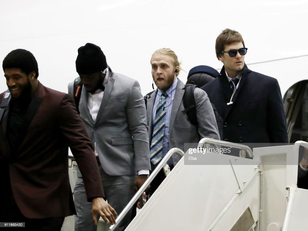 Quarterback Tom Brady #12 of the New England Patriots arrives with his teammates for Super Bowl LII on January 29, 2018 at the Minneapolis-St. Paul International Airport in Minneapolis,Minnesota.