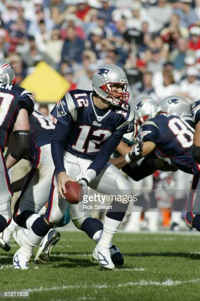 Quarterback Tom Brady of the New England Patriots attempts a hand-off during the game against the Miami Dolphins at Gillette Stadium on October 10,...