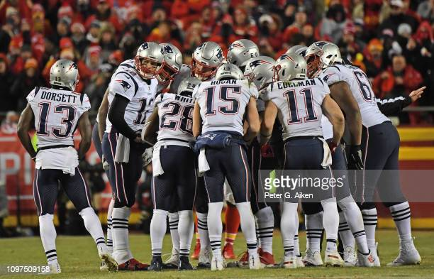 Quarterback Tom Brady of the New England Patriots calls out instructions in the huddle during the second half of the AFC Championship Game against...