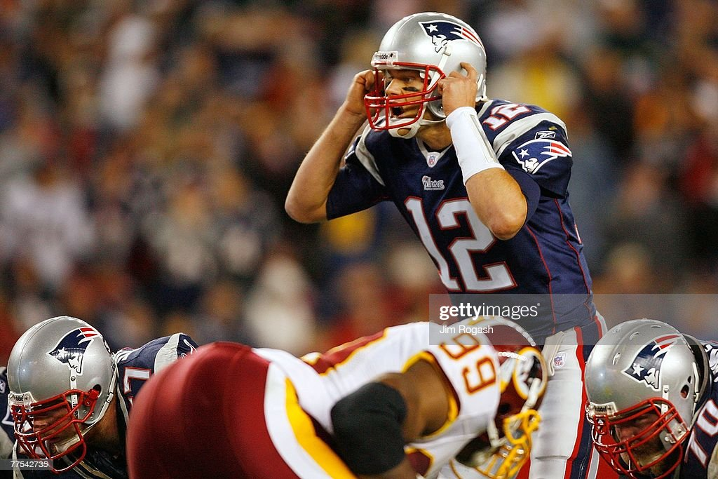 Quarterback Tom Brady #12 of the New England Patriots calls out the play in the second half against the Washington Redskins on October 28, 2007 at Gillette Stadium in Foxboro, Massachusetts. The Patriots defeated the Redskins 52-7.