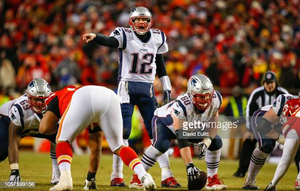 Quarterback Tom Brady of the New England Patriots calls signals in overtime against the Kansas City Chiefs during the AFC Championship Game at...