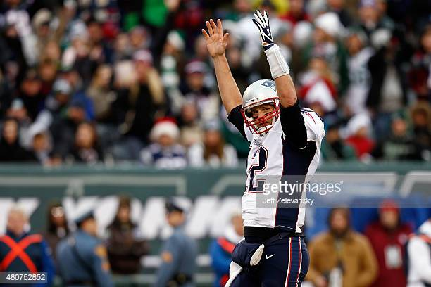 Quarterback Tom Brady of the New England Patriots celebrates a fourth quarter touchdown against the New York Jets during a game at MetLife Stadium on...