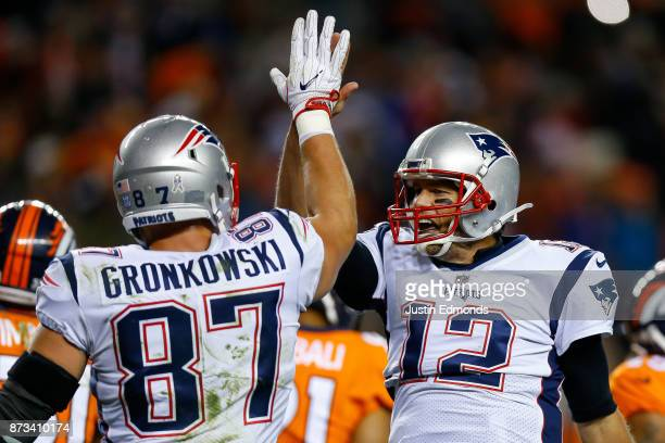 Quarterback Tom Brady of the New England Patriots celebrates a fourth quarter touchdown with Rob Gronkowski during a game against the Denver Broncos...