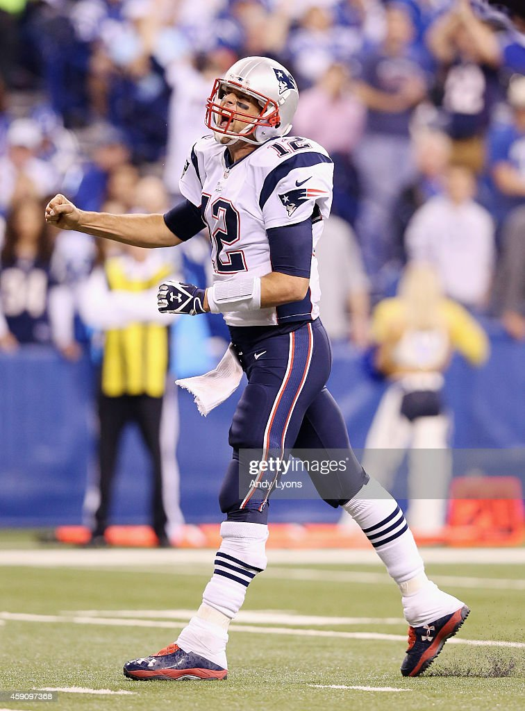 Quarterback Tom Brady #12 of the New England Patriots celebrates after a touchdown against the Indianapolis Colts during the third quarter of the game at Lucas Oil Stadium on November 16, 2014 in Indianapolis, Indiana.