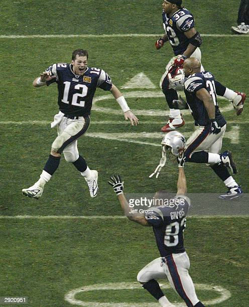 Quarterback Tom Brady of the New England Patriots celebrates after defeating the Carolina Panthers 3229 in Super Bowl XXXVIII at Reliant Stadium on...
