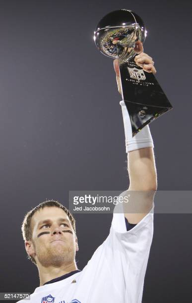 Quarterback Tom Brady of the New England Patriots celebrates with the Lombardi trophy after defeating the Philadelphia Eagles in Super Bowl XXXIX at...
