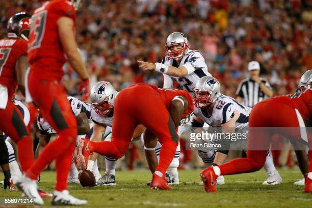 Quarterback Tom Brady of the New England Patriots controls the offense during the second quarter of an NFL football game Tampa Bay Buccaneers on...