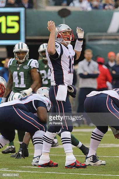 Quarterback Tom Brady of the New England Patriots directs a play against the New York Jets at MetLife Stadium on December 27 2015 in East Rutherford...
