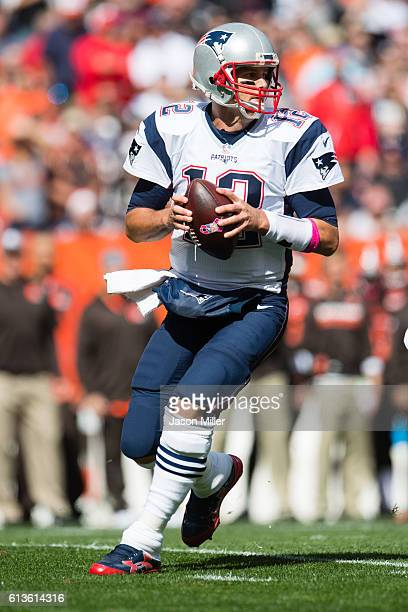 Quarterback Tom Brady of the New England Patriots drops back for a pass during the first quarter against the Cleveland Browns at FirstEnergy Stadium...