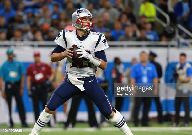 Quarterback Tom Brady of the New England Patriots drops back to pass the ball against the Detroit Lions during the first quarter at Ford Field on...