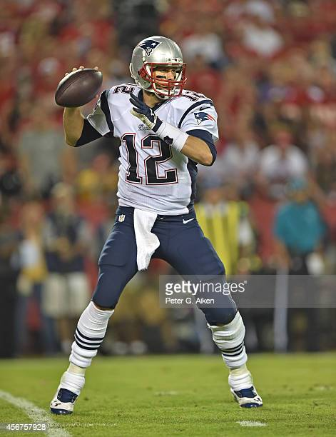 Quarterback Tom Brady of the New England Patriots drops back to pass against the Kansas City Chiefs during the second half on September 29 2014 at...