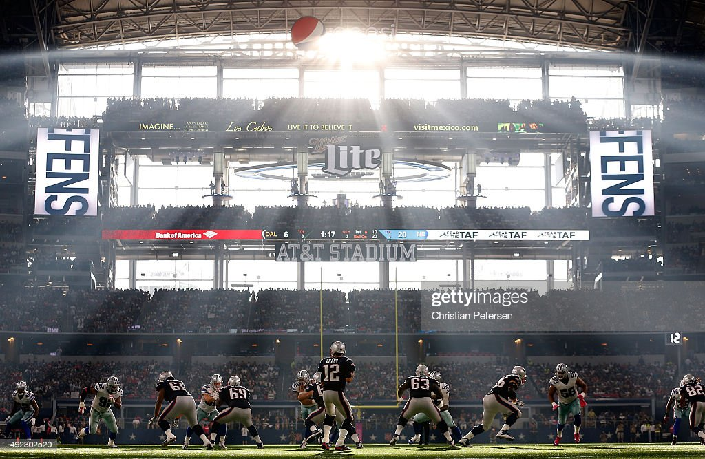 Quarterback Tom Brady #12 of the New England Patriots drops back to pass during the second half of the NFL game against the Dallas Cowboys at AT&T Stadium on October 11, 2015 in Arlington, Texas. The Patriots defeated the Cowboys 30-6.