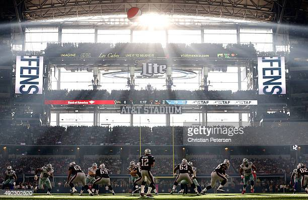 Quarterback Tom Brady of the New England Patriots drops back to pass during the second half of the NFL game against the Dallas Cowboys at AT&T...