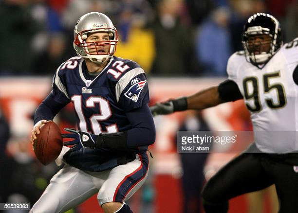 Quarterback Tom Brady of the New England Patriots drops back to pass as Paul Spicer of the Jacksonville Jaguars gives chase during their AFC Wildcard...