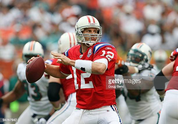 Quarterback Tom Brady of the New England Patriots drops back to pass against the Miami Dolphins at Land Shark Stadium on December 6 2009 in Miami...