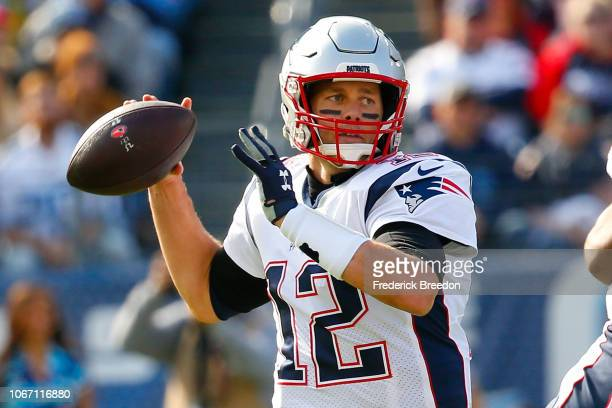 Quarterback Tom Brady of the New England Patriots drops back to throw a pass against the Tennessee Titans at Nissan Stadium on November 11 2018 in...