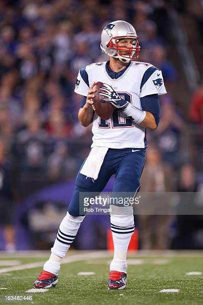 Quarterback Tom Brady of the New England Patriots drops back to throw a pass during the game against the Baltimore Ravens at MT Bank Stadium on...