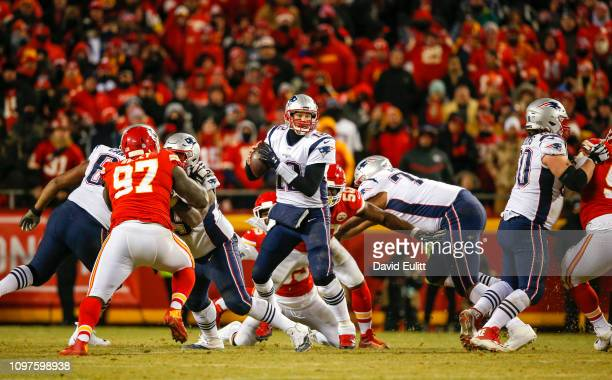 Quarterback Tom Brady of the New England Patriots eludes pressure from the Kansas City Chiefs in overtime during the AFC Championship Game at...