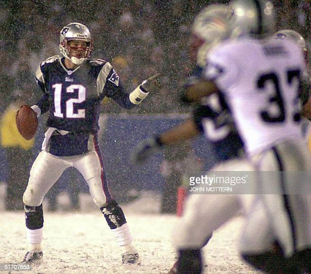 Quarterback Tom Brady of the New England Patriots feels the pressure from the Oakland Raiders defense in the third quarter in their AFC playoff game...