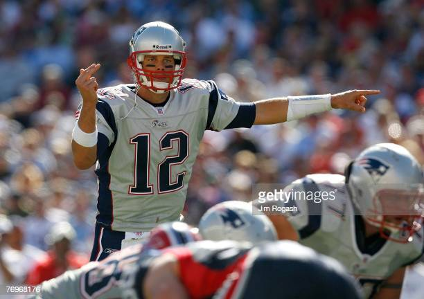 Quarterback Tom Brady of the New England Patriots gestures during a game against the Buffalo Bills at Gillette Stadium on September 23, 2007 in...