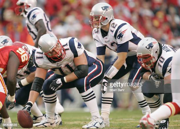 Quarterback Tom Brady of the New England Patriots gets ready for the hike from center Russ Hochstein during the game against the Kansas City Chiefs...