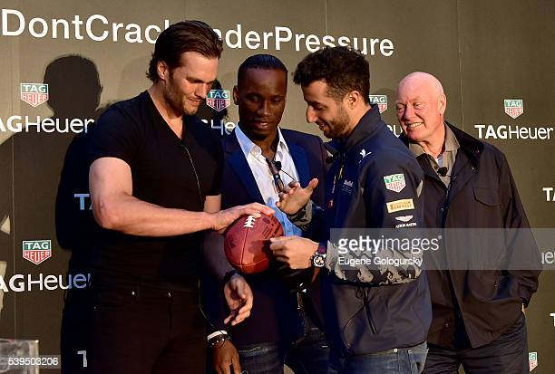 Quarterback Tom Brady of the New England Patriots gives some tips to Red Bull Formula 1 Team driver Daniel Ricciardo at the TAG Heuer Celebrates The...