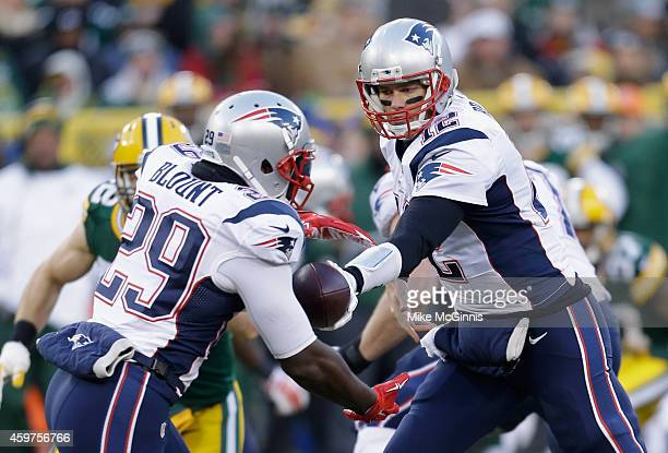 Quarterback Tom Brady of the New England Patriots hands the ball off to running back LeGarrette Blount in the first quarter of the NFL game against...
