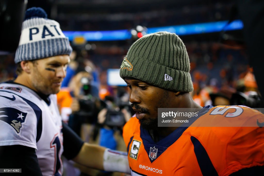 Quarterback Tom Brady #12 of the New England Patriots has a word with outside linebacker Von Miller #58 of the Denver Broncos after a 41-16 Patriots win at Sports Authority Field at Mile High on November 12, 2017 in Denver, Colorado.