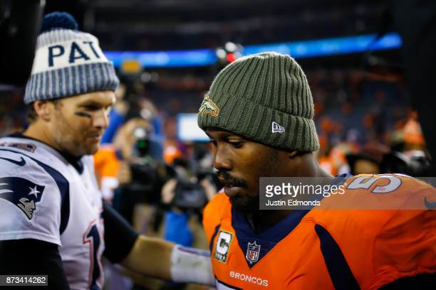 Quarterback Tom Brady of the New England Patriots has a word with outside linebacker Von Miller of the Denver Broncos after a 4116 Patriots win at...